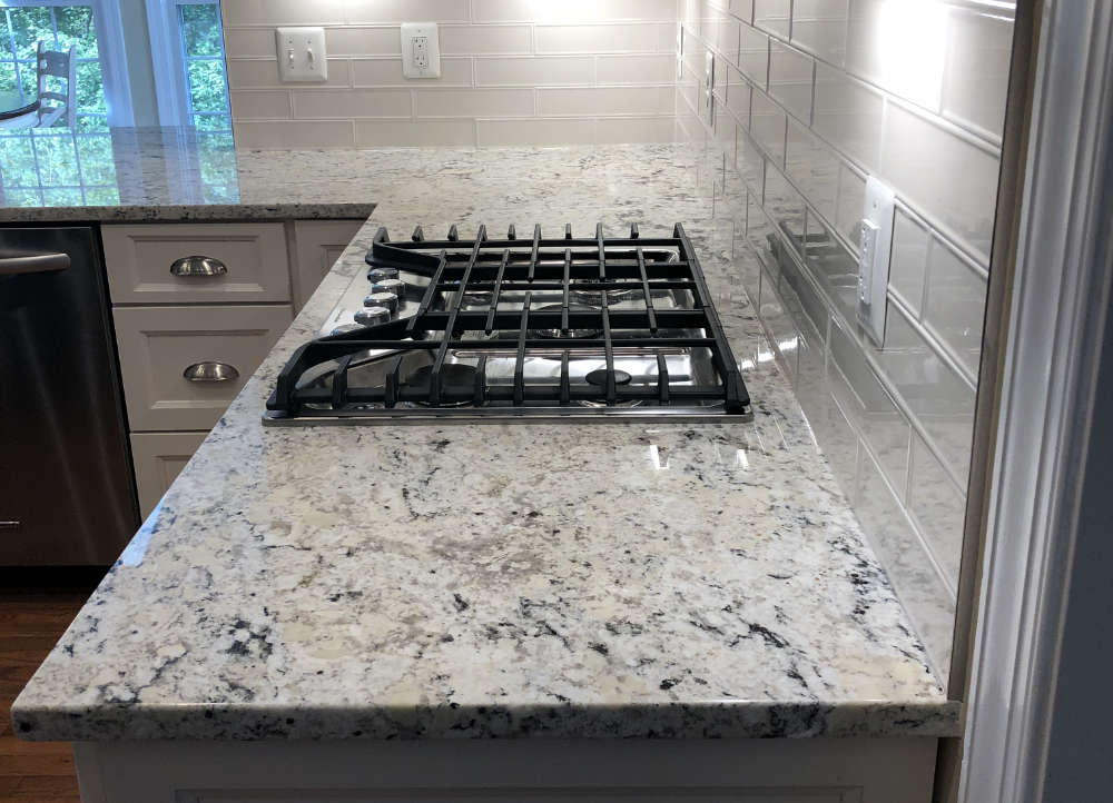 a beautiful piece of granite countertop looking straight into the cooktop
